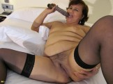 Chubby mature with smallish tits and a hairy pussy.
