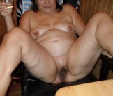 mature woman spread her legs to show that hairy pussy