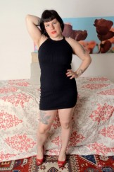 Chubby mature Olivia slips out of her black dress.
