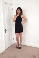 Mature hairy Penelope removes her little black dress.