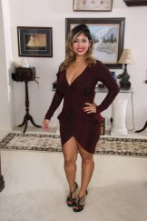 Chubby mature Latina Jamie gets naked in her living room.