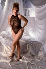 Mature babe in bodysuit