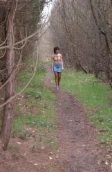 Mature – Slim hairy dark haired lady strips in woodland