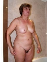 Cute granny with perky boobs and hairy pussy