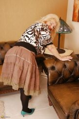 Horny granny gets wet on her couch (update)
