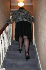Chubby mature Claire posing at the top of her stairway.