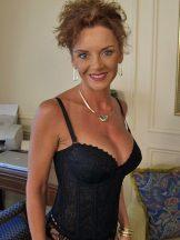 Janet: bustier, garters, hose–and bikini tan line