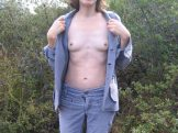 Sexy Hairy Mature undresses outdoors