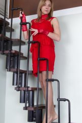Alisia stands and strips on her staircase
