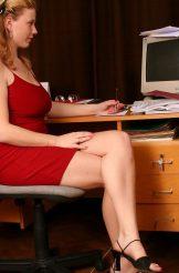 Busty Redhead Nikol in a red dress