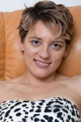 Calina strips naked on her leather sofa