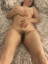 My wife showcasing her pussy on bed