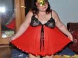 My bbw wife is in a red dress and mask.