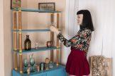 Little Olive models by her blue sideboard