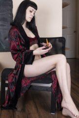 Little Olive slides off her silk robe to orgasm