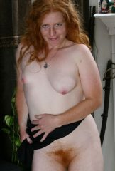 Chubby redhead with differently sized tits